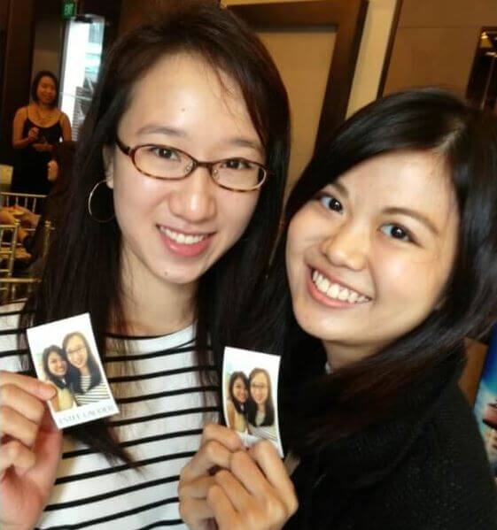happy users with a photo sticker in hand